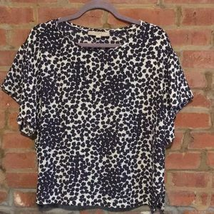 Navy and white flutter sleeve top.